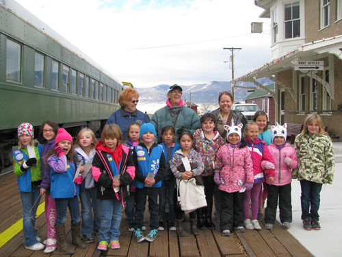 Girl Scouts riding trains