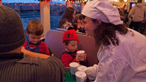 Santas Helpers serving sweet treats to passengers on the Polar Express
