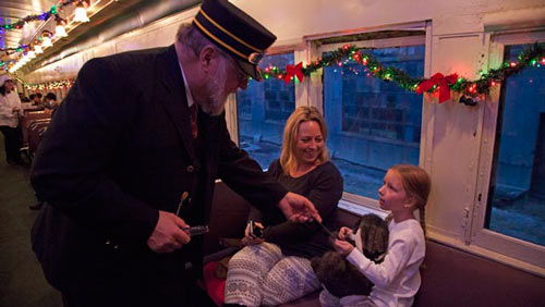 The Christmas Train conductor knows Santa.<br>You can ask him about the North Pole.