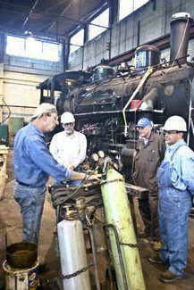 Campers experience all phases of railroading.<br>Here the participants are learning about the cutting torch.